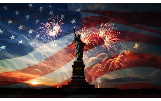 Statue of Liberty with American Flag and Fireworks